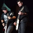 Tyler Connolly and Dave Brenner of Theory of a Deadman swap licks at Common Ground 2011