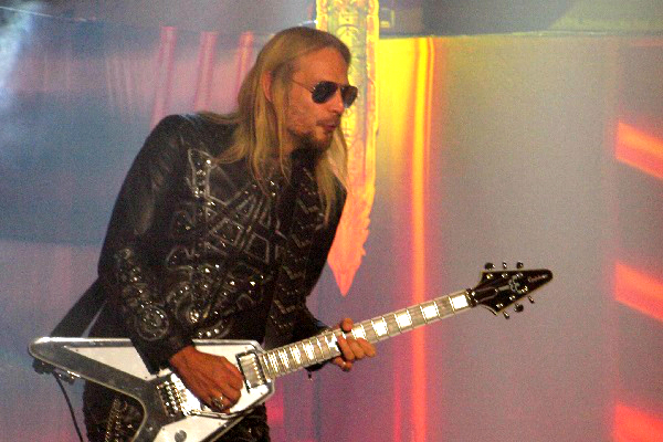 Judas Priest guitarist Richie Faulkner performing live.