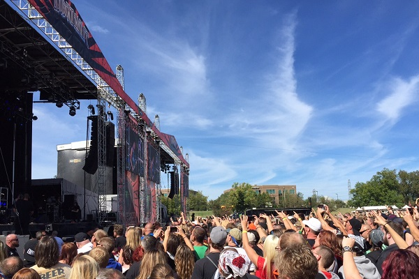 Fans crowd the stage during a popular summertime music festival.