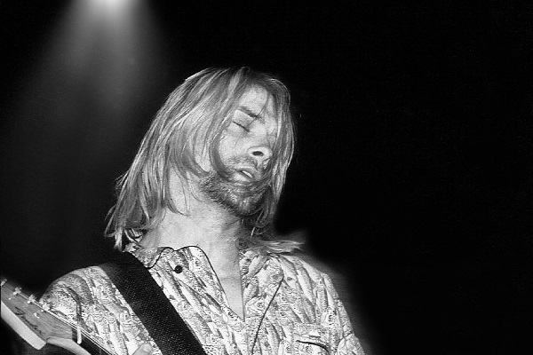 A classic photo of Kurt Cobain performing live in the early 1990s.