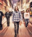 Kevin Martin and the current incarnation of Seattle rockers Candlebox pictured on a vibrant city street.