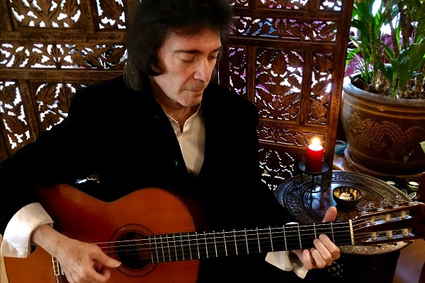 Interview with Steve Hackett of Genesis, positioned with his acoustic guitar.
