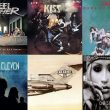 Album art from Christina Aguilera, Queen, Finger Eleven, Kiss, Steel Panther and the Beastie Boys.