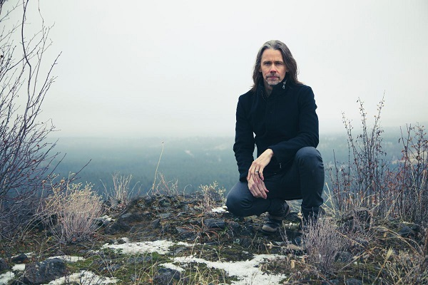Myles Kennedy of Alter Bridge and Slash pictured on a snowy hill.