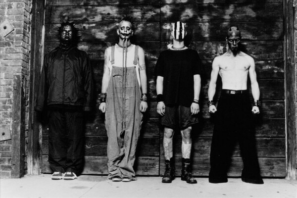 A retro, black and white press photo of nu-metal band Mudvayne, featuring the guys in masked attire.