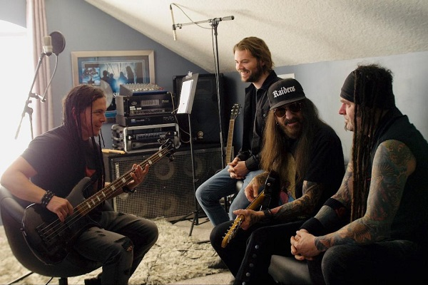 A photo of nu-metal band Saliva in the studio working on new music.