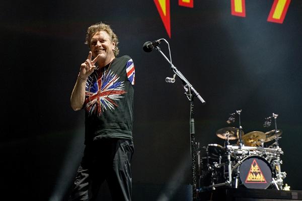 Def Leppard drummer Rick Allen performing live, wearing a Def Leppard shirt.