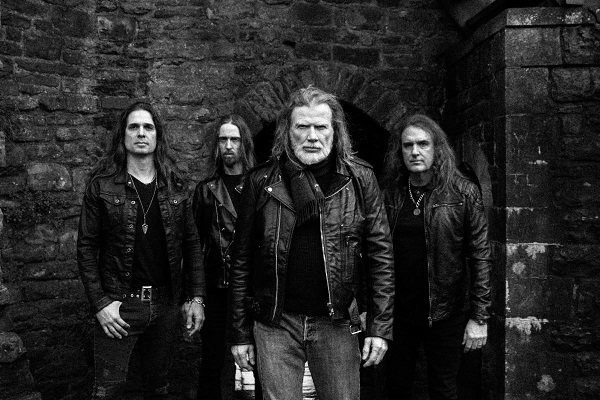 Metal band Megadeth stand for a black and white press photo.