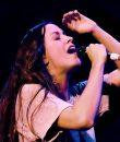 Alanis Morisette performing live.
