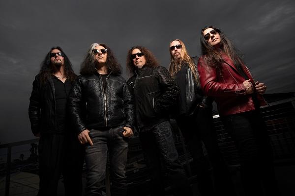 Thrash metal band Testament poses for a promo photograph.