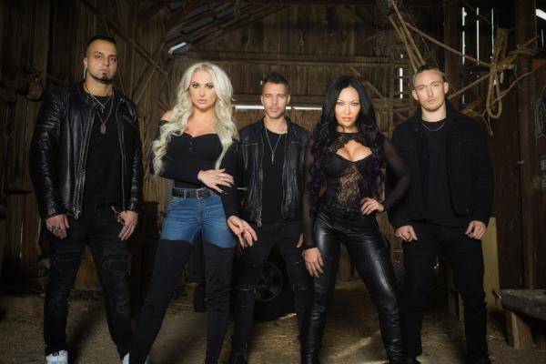 Butcher Babies promo photo, featuring the band in a rustic setting.