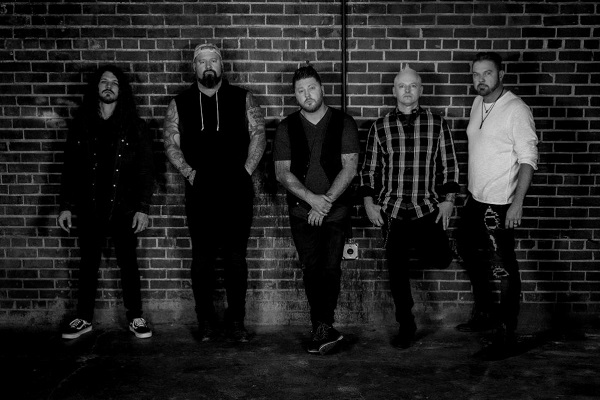 Mississippi rock band Saving Abel stand for a 2021 promo photo.