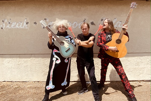 The Melvins rocking out in a colorful press photo.