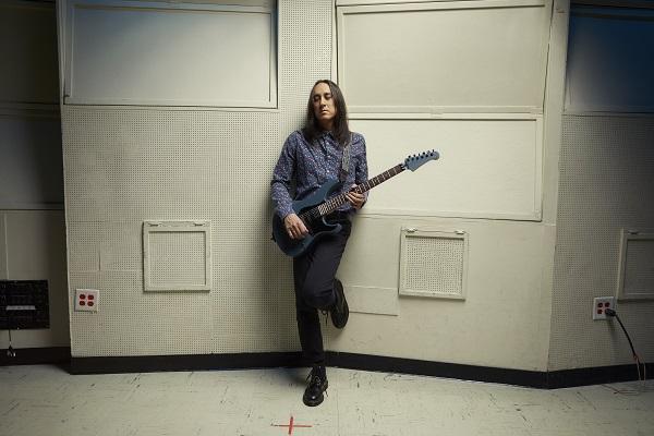 Jeff Schroeder of The Smashing Pumpkins slinging his six-string guitar.