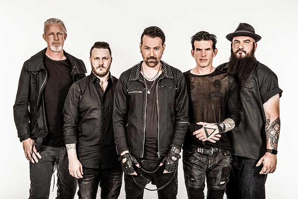 Nu-metal band Adema posing for a press photo in front of a white background.