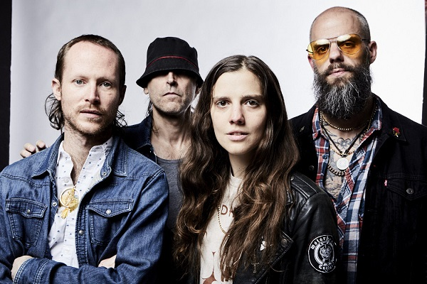 Promo photo of metal band Baroness, with band members standing amid a white background.