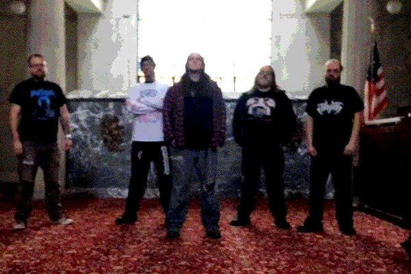 Detroit metal band Centenary posting in an abandoned building.