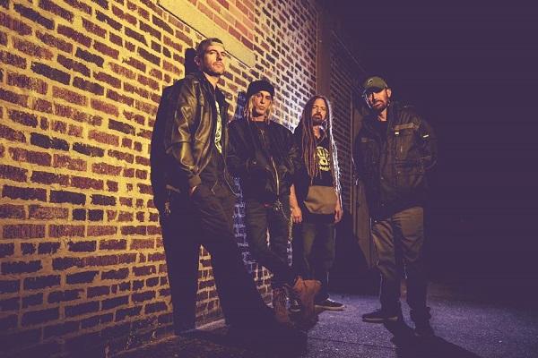A photo of Mount Pleasant, Michigan, metal band Nagazi standing against a brick wall.