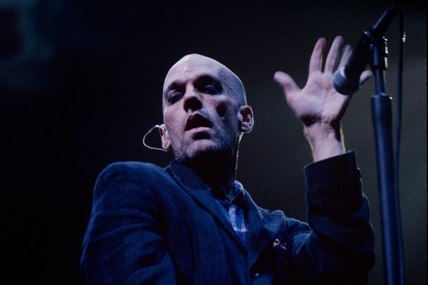 R.E.M. vocalist Michael Stipe performing live in Detroit, Michigan, in 1992.