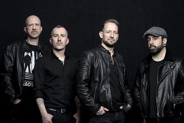 Danish metal band Volbeat standing for a press photo.
