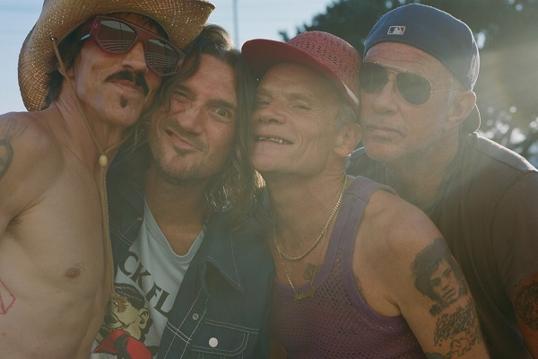 The members of band member the Red Hot Chili Peppers standing in the sunlight for a promo shot.